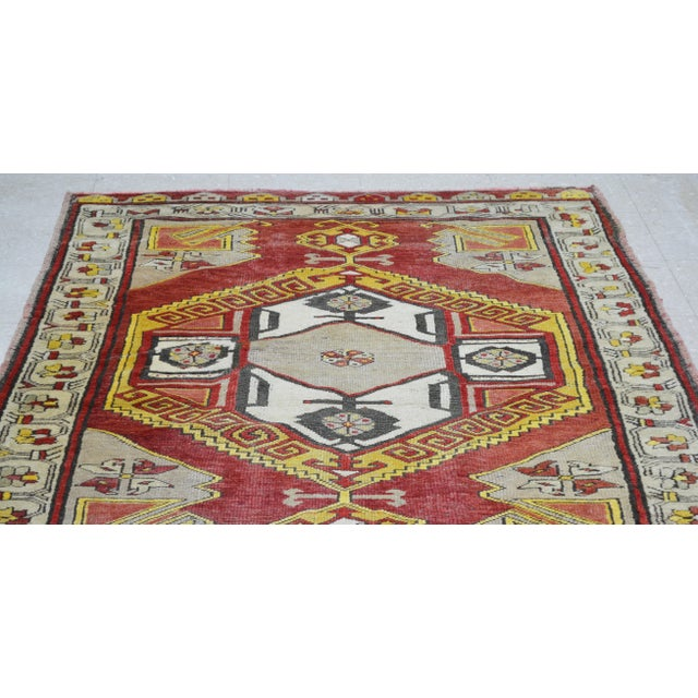 Vintage Turkish hand knotted rug with great colors, fine weave and beautiful pattern with soft texture.