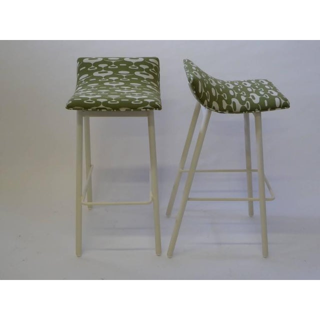 Originals from the 1950s, this pair of bar stools are early ergonomic designs and a comfy perch at the bar. These stools...