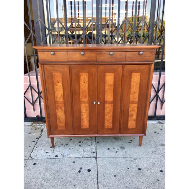 Now available is a gorgeous vintage highboy. This mid-century highboy features tons of storage with over nine drawers ,...