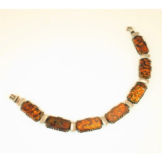 Offered here is a Victorian sterling and art glass panel bracelet from about the 1870s. The sinuous linked panel...