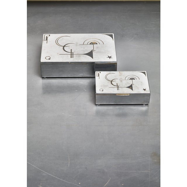 A pair of 1930s decorative (desk top) boxes from Germany. The boxes are made of chrome plated metal and have a wood...