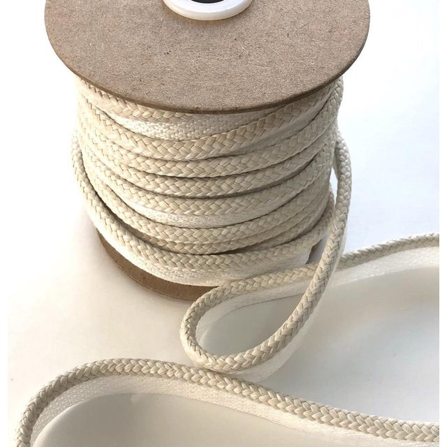 "One 10 yard spool of 1/4"" (.25"") braided cord with 1/2"" flange. Total height=3/4"" This item is suitable for Indoor/Outdoor..."