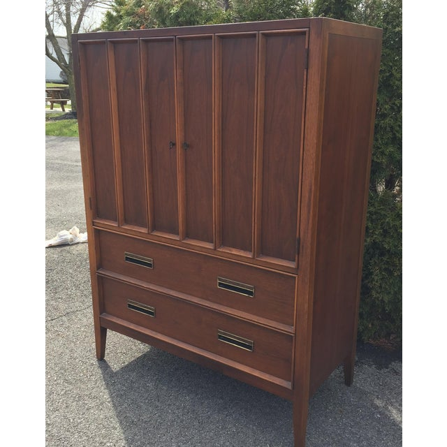 Excellent looking Gentleman's chest by Drexel, part of the Paragon line. Behind the two top doors are three large...