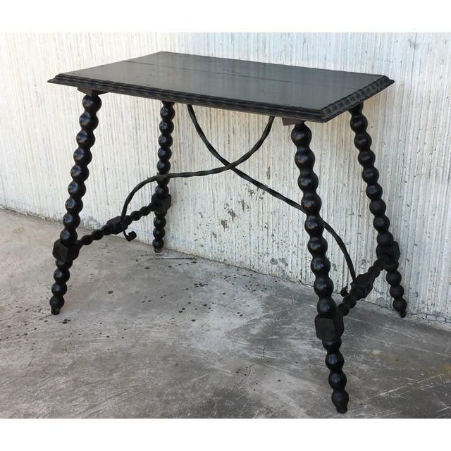 About 19th century Spanish Baroque ebonized side table with iron stretcher and carved top in walnut. Details PRODUCTION...