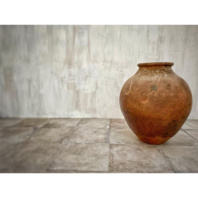 An antique terracotta vessel from Badajoz. This piece was built by hand without a potter's wheel using a traditional...