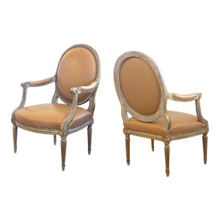 Pair of French Louis XVI Style Grey/Green Painted and Parcel-Gilt Arm Chairs For Sale