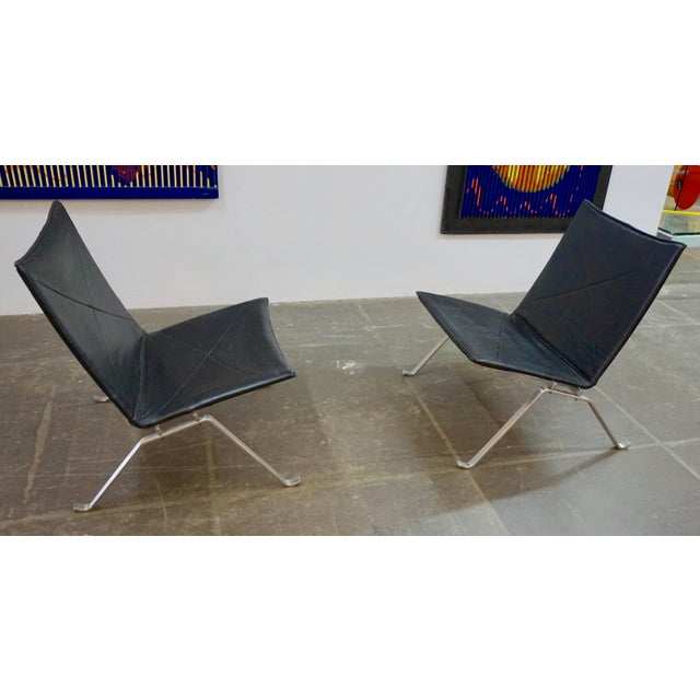 Designed by Kjaerholm in the 1950's and recently manufactured by Fritz Hansen.Classic black leather upholstery on brushed...
