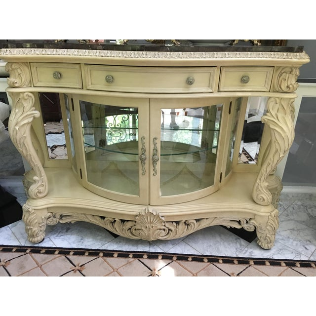 Beautiful French/Hollywood Glam style sideboard-buffet-server display cabinet made by Pulaski. Ornately carved with...