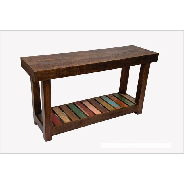 Solid and beautiful, this table has a simple design accented with a palette color and solid block style legs. This rustic...