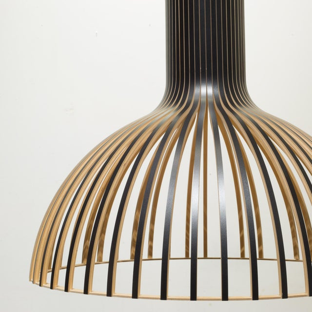 ABOUT The Victo 4250 Pendant features a shade made from laminated birch slats connected by rings of aircraft plywood...