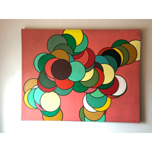 Offered is an oversized mid century hard edge painting featuring layers of colorful dots overlapping each other painted...
