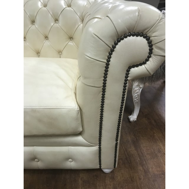 NEW. Perfectly tufted chesterfield sofa. The workmanship on this classic sofa is divine! Made with leather and nail studs....