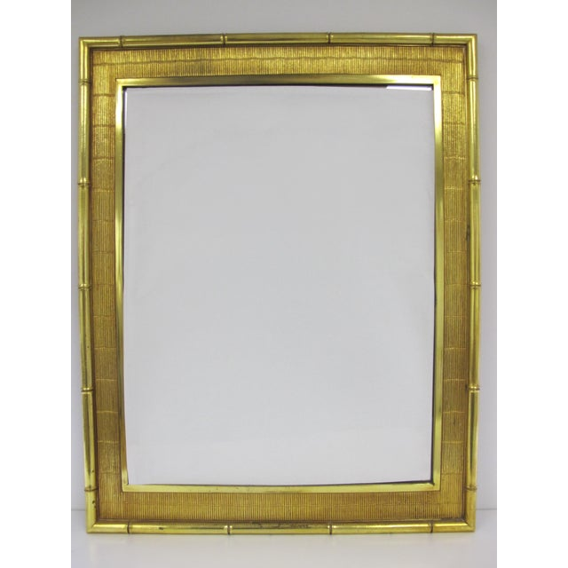 Vintage faux bamboo mirror made by Syroco out of the Syroco staple Resin Material. Original hardware on back allows...