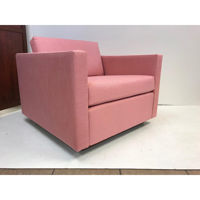 Pair of Harvey Probber cube lounge/club chairs on a solid walnut plinth base. Upholstered in a pink linen blend fabric....