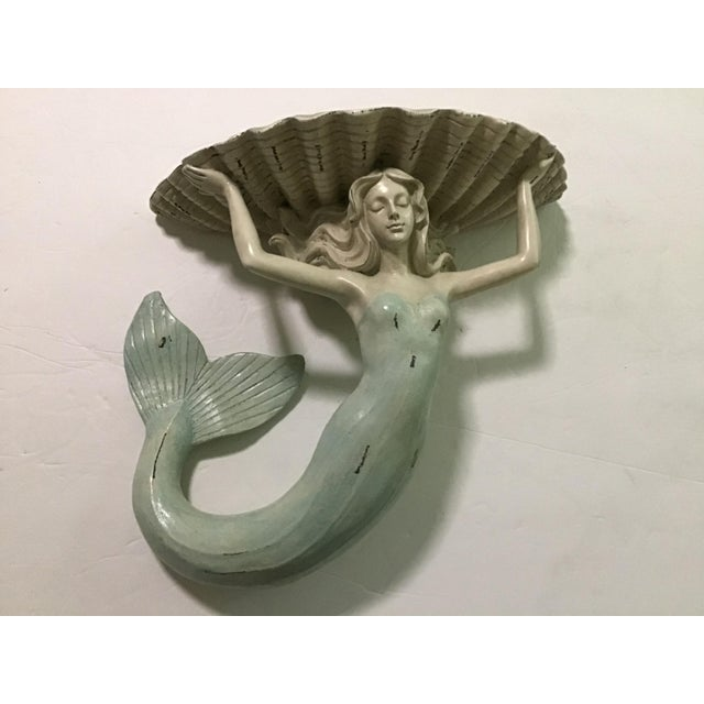 Nautical Sea Palm Beach wall sconce of a beautiful lady holding a shelf. Palm Beach Appeal Can go in any room