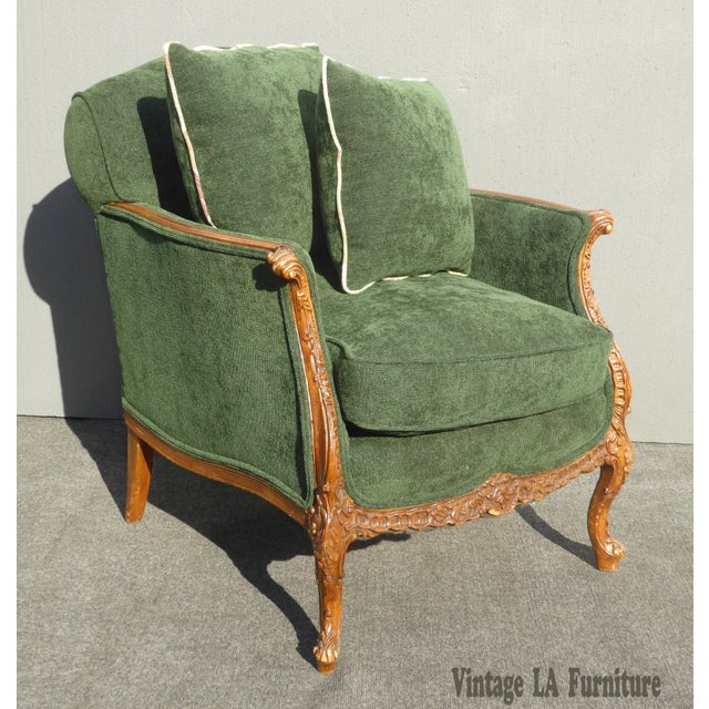 Vintage French Country style carved wood with green velvet accent chair w pillow. Gorgeous chair in great condition....