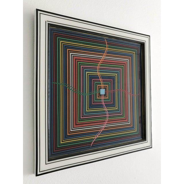 Epicenter by Mauro Oliveira, signed. Vinyl tapes, acrylic paint covered with resin on wood frame. A certificate of...