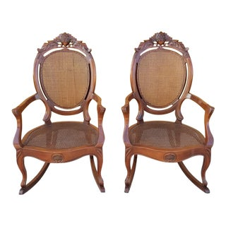 1920s Victorian Walnut CarvedRocking Chair With Cane Seat and Back - a Pair For Sale