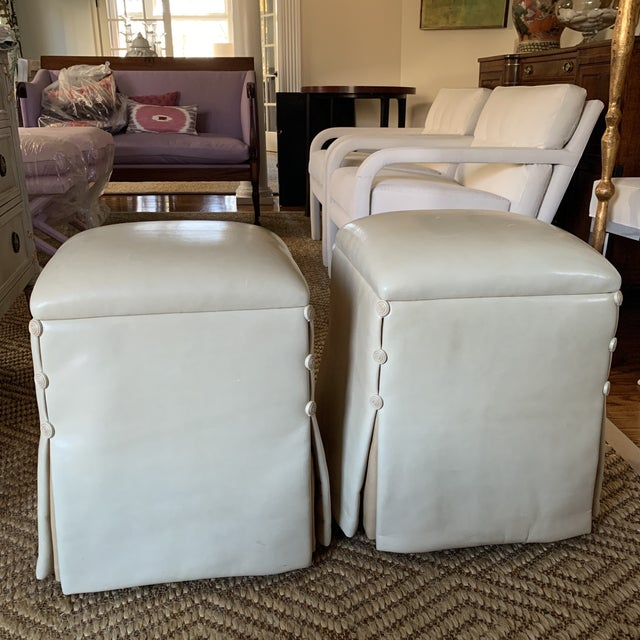 A pair of luxuriously buttery soft lamb skin custom Ottomans by J. robert Scott. Color is a parchment or ivory color....