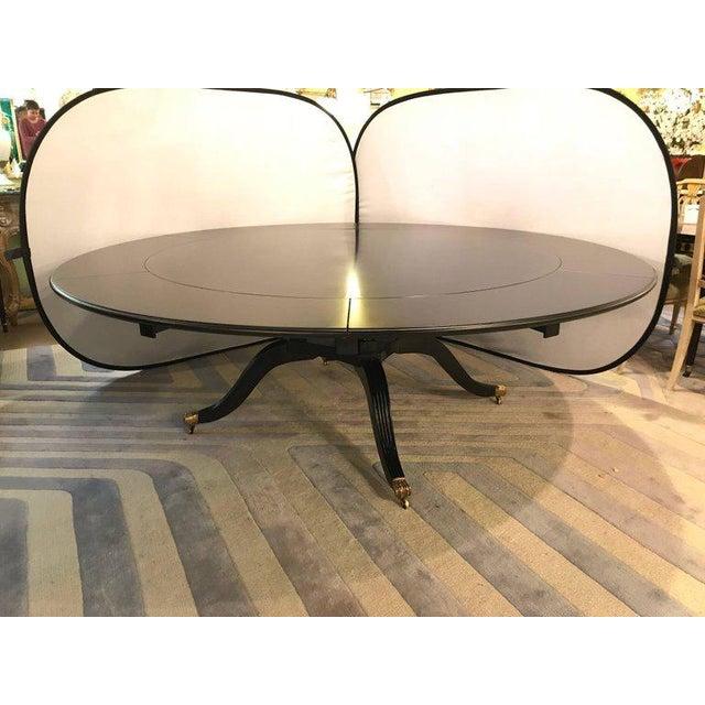 Hollywood Regency Monumental Hollywood Regency Custom-Made Ebony Circular Extending Dining Table For Sale - Image 3 of 12