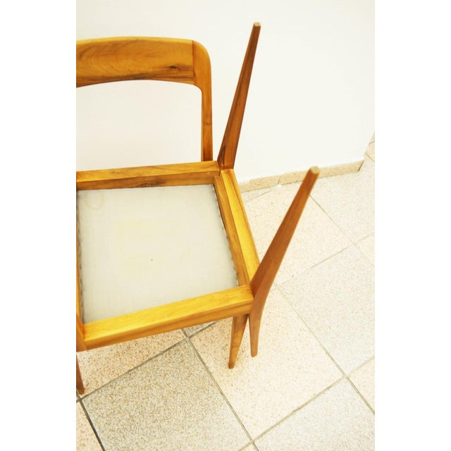 This set of two model A 7 chairs was designed and manufactured by Carl Auböck during the 1950s. The chairs feature frames...