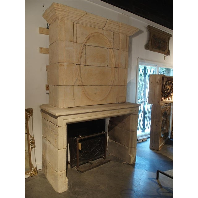 Early 19th Century Early 1800s Carved Limestone Trumeau Fireplace Mantel from Loire Valley, France For Sale - Image 5 of 11