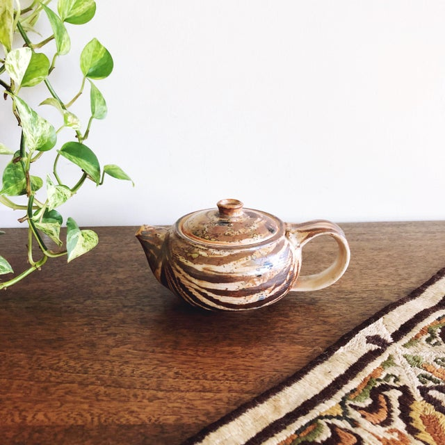 Vintage hand thrown, built, and glazed Japanese stoneware teapot with nuanced earth tones glaze. One of a kind studio...