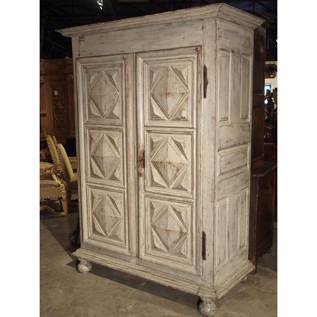 From the early 1600's, this rare, Period Louis XIII armoire has bold diamond point motifs on its two front doors. The...