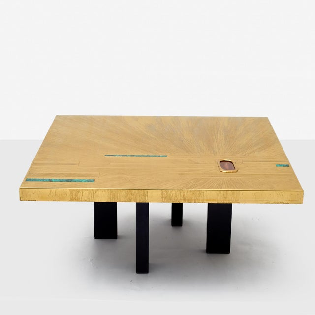 Elias Segura Pasqual Coffee Table. An artistic coffee table of etched brass with inlay of malachite and agate. Incised...