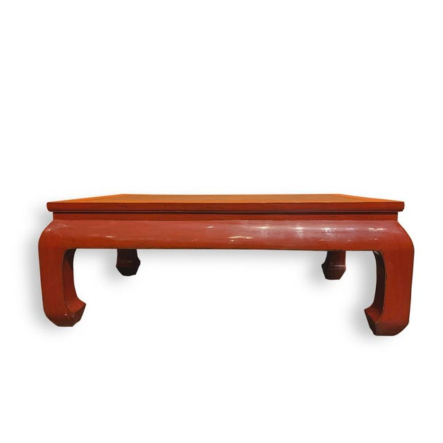 This is Ming style coffee table made out of Asian elm wood. Topping with rattan which blends well with the red color for...