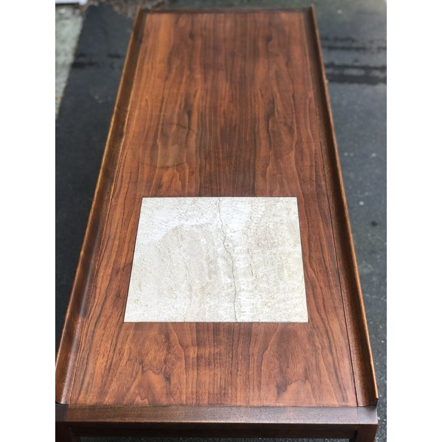 Versatile walnut coffee table with a pair of black tufted vinyl benches conveniently stored beneath. Inlaid stone (marble?...