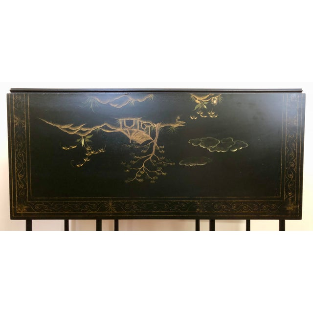 Baker Furniture, Historic Charleston Reproductions black lacquer Chinoiserie drop leaf gate leg table. This is a gorgeous...