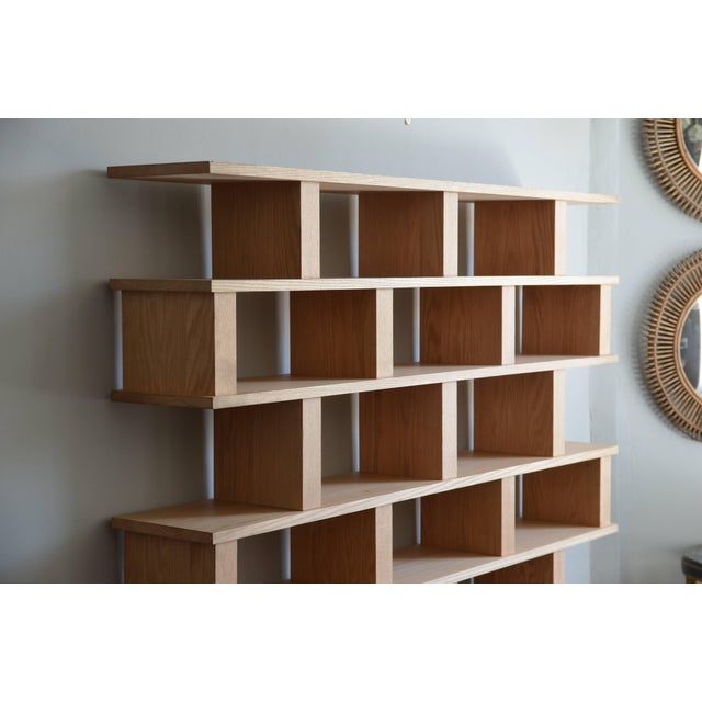 Chic 'Verticale' polished oak shelving unit by Design Frères. Handmade in solid oak, polished and with a clear matte...
