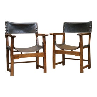Pair of Spanish Baroque Chestnut and Leather Armchairs For Sale