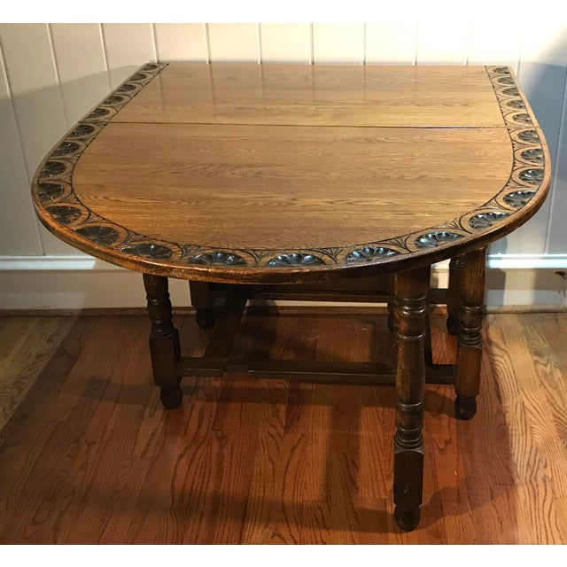 Beautiful carved top DropLeaf Table with gate leg construction. Very heavy, solid oak. Great size and very versatile...