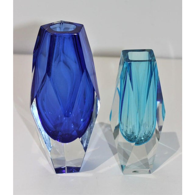 The stylish two piece set of Murano glass vases date to the 1970s and were created by Artistic Cristal. Note: The shorter...