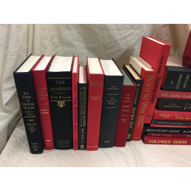 """Decorative book lot in excellent condition. Red and Black Color. These books measure 33.5"""" wide x 7"""" deep x 10"""" tall. 28..."""