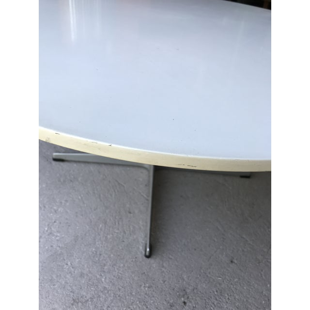 Vintage Arne Jacobsen for Fritz Hansen white laminate coffee table. Table is in good condition, with some wear, a few...