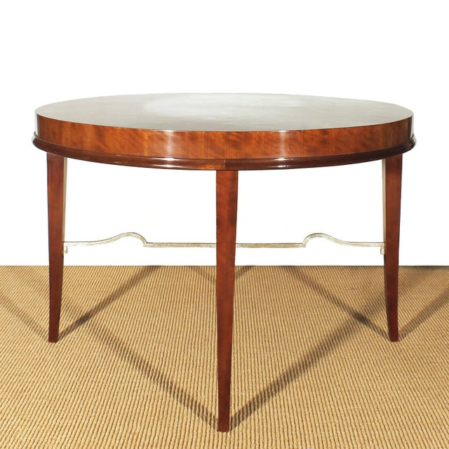 Nice mottled mahogany round sidetable with silver leaves gilded spacer. Design: De Coene Belgium c. 1940.
