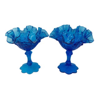 Mid 20th Century Fenton Crimped Blue Glass Floral Design Compotes / Stemmed Bowls ~ - a Pair For Sale