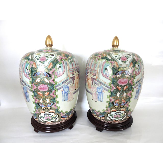 Pastels abound on this pair of porcelain Rose Mandarin ginger jars topped with gold finials. Each jar is hand painted, and...