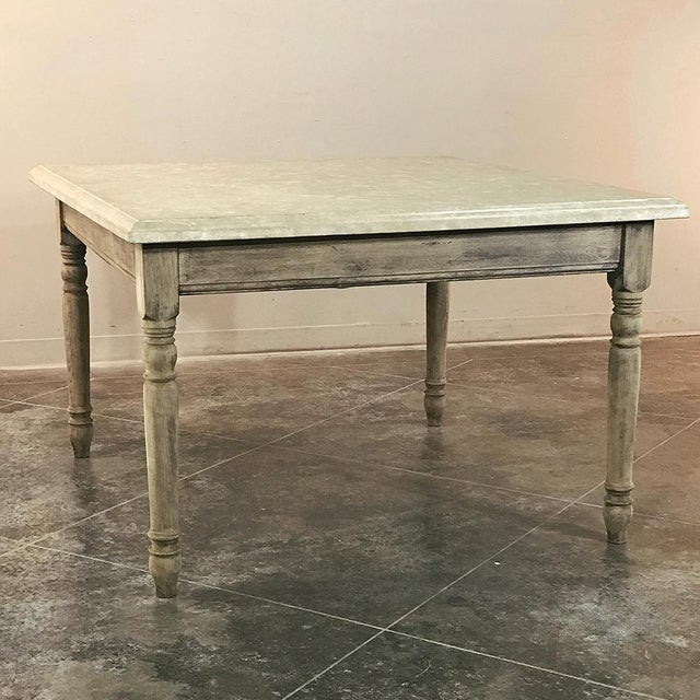 19th Century French Rustic Limestone Top Game Table - Center Table features tailored architecture with turned legs and a...