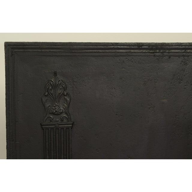 Large antique cast iron fireback with two tall pillars. Excellent condition, can be used in a fireplace or as backsplash....