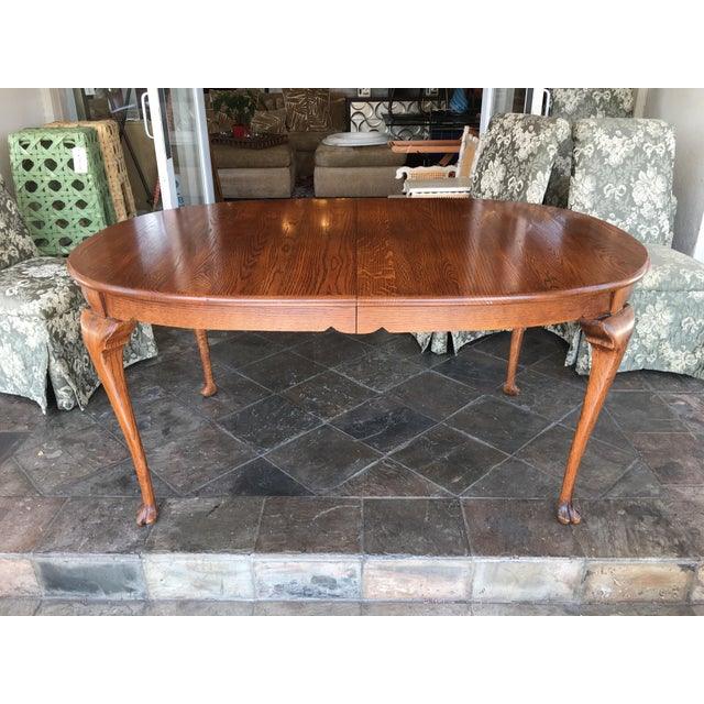 Design Plus Gallery has an Oak oval dining table. This unique table sits on Queen Anne legs that end in a very unusual...
