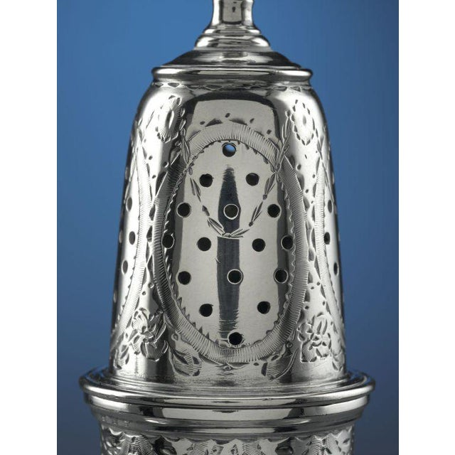 A rare and superb set of American silver salt cellars, salt spoons and pepper casters created by Boston silversmith...