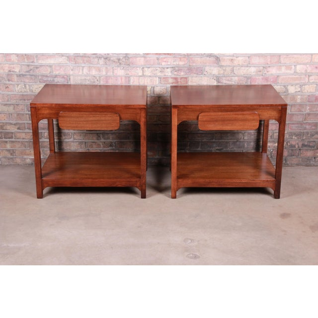 """An exceptional pair of mid-century modern elm wood nightstands or side tables By Edward Wormley for Drexel """"Precedent""""..."""