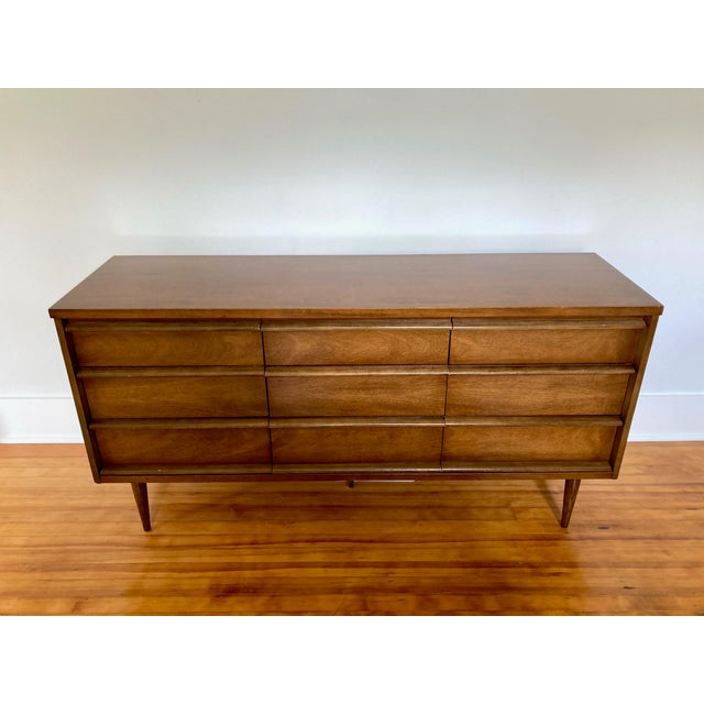Vintage Mid Century Modern Bassett low boy dresser with 9 drawers. Solid wood, no laminate! The matching high boy 4 drawer...