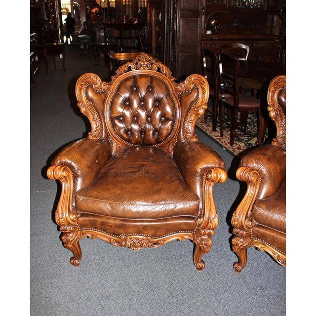 This 20th century French parlor set is made in the Rococo style and includes one sofa and two side chairs. Features...