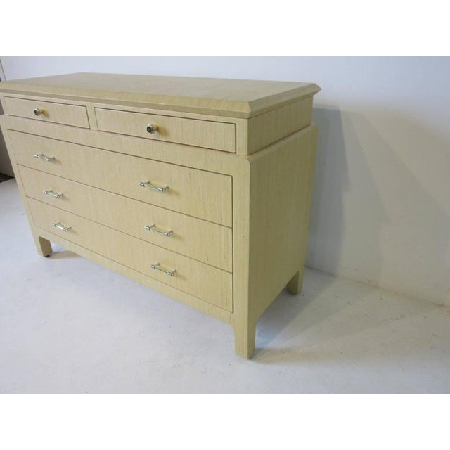 A well crafted dresser commode linen wrapped and enameled in a nice mellow sand tone with two small upper drawers and...