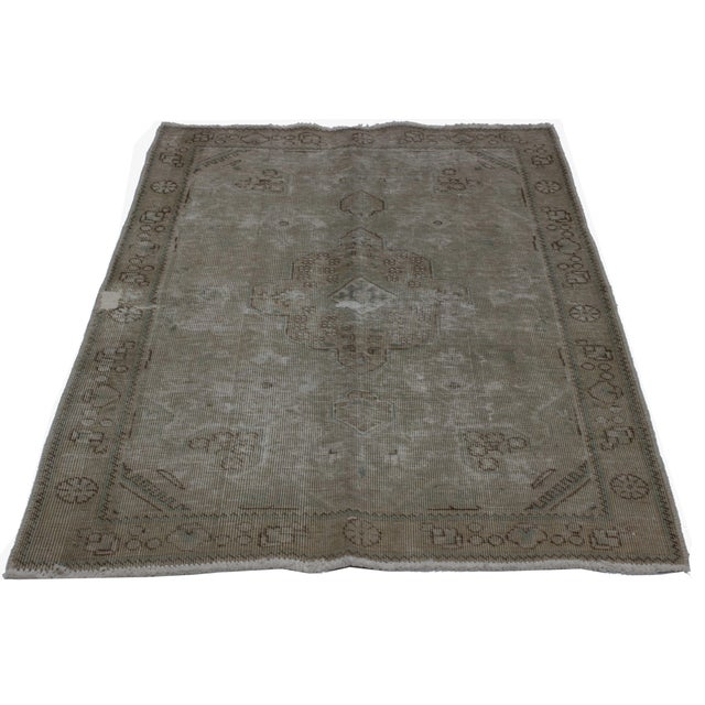 This elegant, distressed, vintage Persian Tabriz rug features a modern industrial style. It features a highly fashionable...